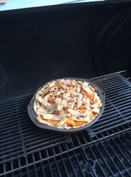 Peach pie on the grill